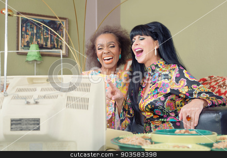 Cute Retro Ladies Laughing stock photo, 1960s style women laughing while watching television by Scott Griessel