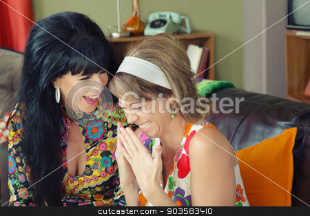 Pair of Giggling Friends stock photo, Pair of beautiful European giggling 1960s women by Scott Griessel