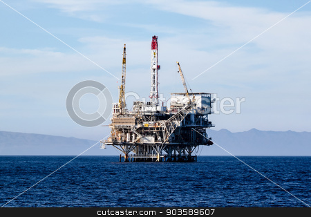 Two Oil Rigs stock photo, Oil rigs in front of the Ventura coast. by Henrik Lehnerer