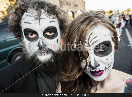 Couple in Dia De Los Muertos Face Paint stock photo, TUCSON, AZ/USA - NOVEMBER 09: Two unidentified people in dramatic facepaint at the All Souls Procession on November 09, 2014 in Tucson, AZ, USA. by Scott Griessel