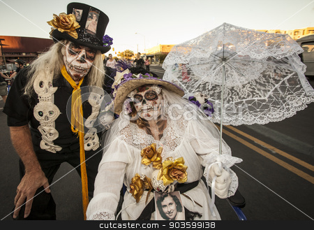 Senior Couple in Dia De Los Muertos Face Paint stock photo, TUCSON, AZ/USA - NOVEMBER 09: Two unidentified senior people in dramatic facepaint at the All Souls Procession on November 09, 2014 in Tucson, AZ, USA. by Scott Griessel