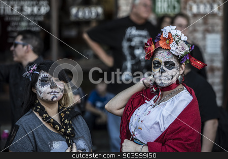 Women in Dia De Los Muertos Makeup stock photo, TUCSON, AZ/USA - NOVEMBER 09: Two unidentified women in facepaint at the All Souls Procession on November 09, 2014 in Tucson, AZ, USA. by Scott Griessel