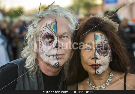Couple in Dia De Los Muertos Makeup stock photo, TUCSON, AZ/USA - NOVEMBER 09: Two undientified people in facepaint at the All Souls Procession on November 09, 2014 in Tucson, AZ, USA. by Scott Griessel