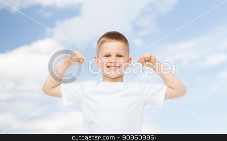 happy little boy in white t-shirt flexing biceps