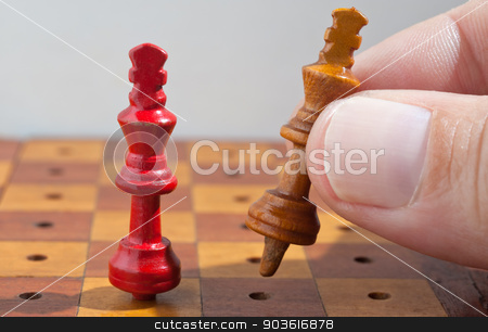 wooden chess kings.  stock photo, Hand with playing wooden chess kings.  by Pablo Caridad