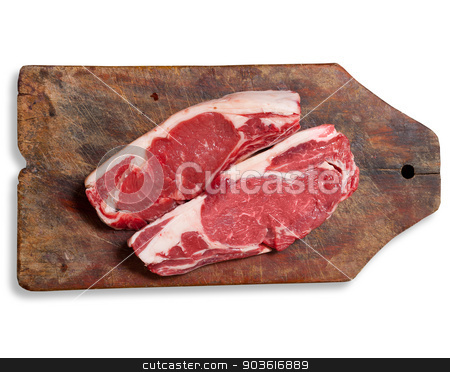 Raw meat on wooden table. Isolated, clipping path. stock photo, Argentinean