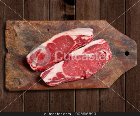 Raw meat on wooden table. stock photo, Argentinean