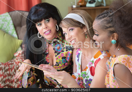 Ladies Admiring LP Record stock photo, Three diverse smiling female friends looking at vintage LP record by Scott Griessel