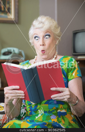 Startled Woman Reading a Book stock photo, Startled Caucasian woman reading hard cover book by Scott Griessel