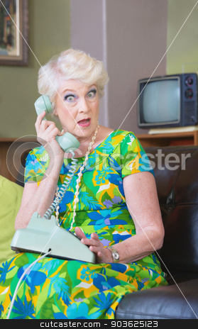 Surprised Woman on Phone stock photo, One surprised woman in conversation rotary telephone by Scott Griessel