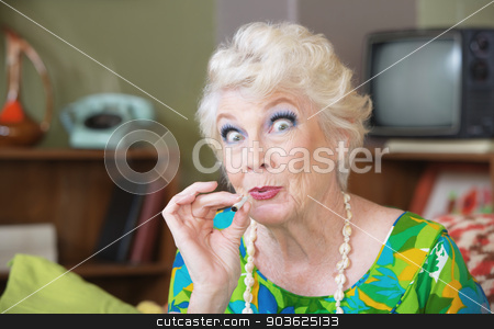 Lady Smoking Pot stock photo, Excited Caucasian senior woman in green smoking marijuana by Scott Griessel