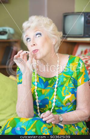 High Senior Lady Smoking stock photo, Senior lady high from smoking weed in 1960s scene by Scott Griessel