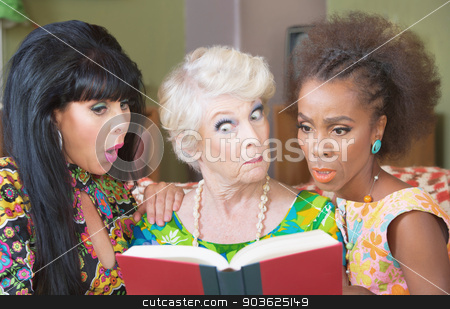 Curious Woman Reading Together stock photo, Trio of cute mature women reading a book by Scott Griessel