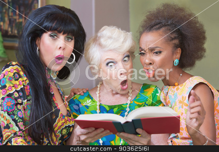Offended Trio of Women stock photo, Three offended mature women reading a hardcover book by Scott Griessel