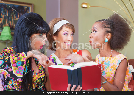 Happy Women Reading stock photo, Happy woman reading book with friends in 1960s fashion by Scott Griessel