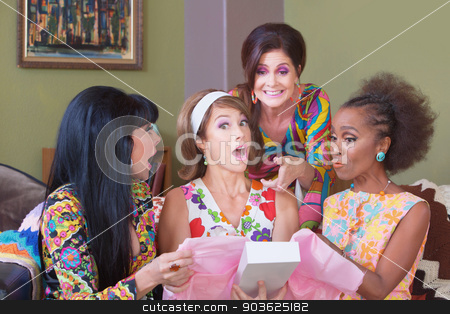 Surprised Woman with Gift stock photo, Cute surprised woman holding box with friends at party by Scott Griessel