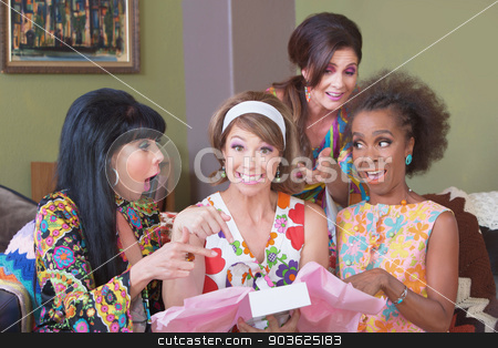Happy Woman with Gift stock photo, Happy woman in hair band holding gift box with friends by Scott Griessel