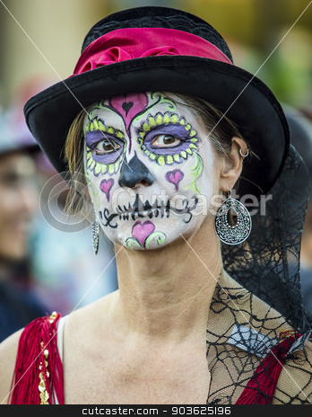 Woman in Dia De Los Muertos Makeup stock photo, Single woman in hat with makeup for Dia De Los Muertos by Scott Griessel