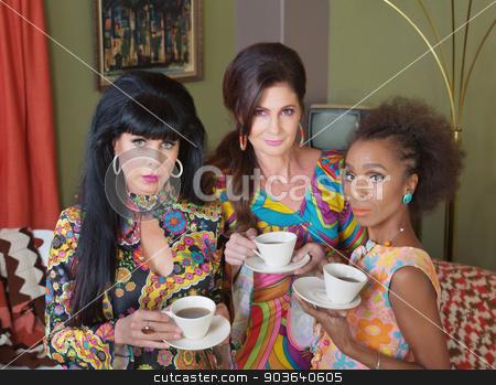 Three Serious Tea Drinkers stock photo, Three beautiful women in 1970s fashion drinking coffee by Scott Griessel