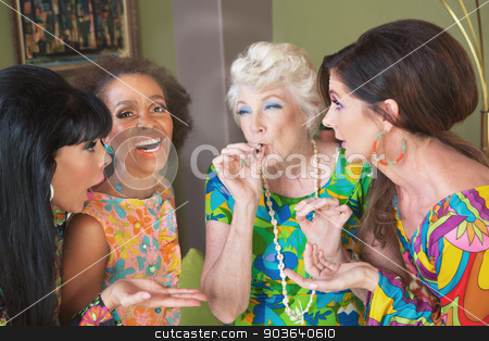 Middle Aged Pot Addicts stock photo, Laughing group of women smoking a joint by Scott Griessel