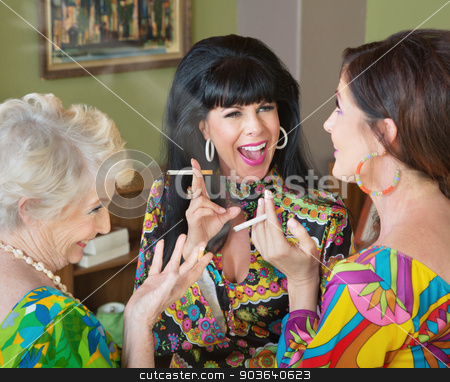 Laughing Middle Aged Women Smoking stock photo, Laughing group of three women smoking cigarettes by Scott Griessel