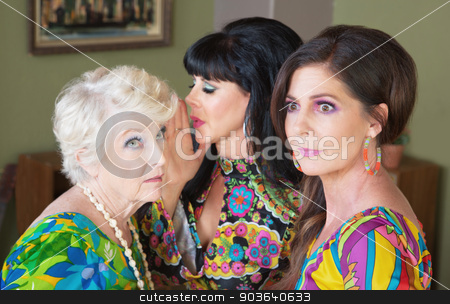 Woman Whispering in Her Ear stock photo, Gossiping ladies sharing secrets and whispering to each other by Scott Griessel