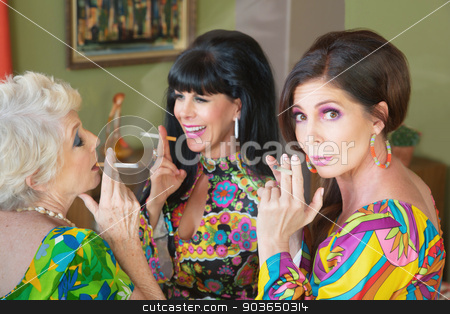 Offended Woman Smoking stock photo, Embarrassed trio of women smoking cigarrettes and talking by Scott Griessel