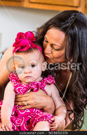 Woman Kisses Baby stock photo, Woman in kitchen kisses her baby by Scott Griessel