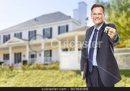 Real Estate Agent with House Keys in Front of Home stock photo, Real Estate Agent with House Keys in Front of Beautiful Home. by Andy Dean