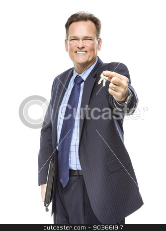 Handsome Real Estate Agent Holding Out Keys to New Home stock photo, Handsome Real Estate Agent Holding Out Keys to New Home Isolated on a White Background. by Andy Dean