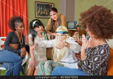 Senior Aged Hippie Gesturing stock photo, Senior hippie with mature group of friends gesturing by Scott Griessel