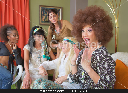 Surprised Lady in Afro with Friends stock photo, Excited lady in afro sitting with friends in 1960s scene by Scott Griessel