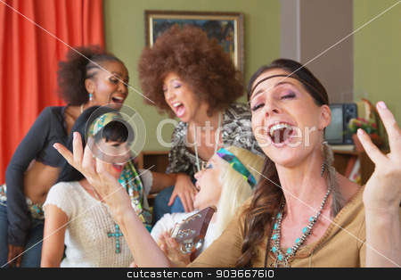 Five Singing Female Hippies stock photo, Five beautiful mature singing women in 1960s clothing by Scott Griessel