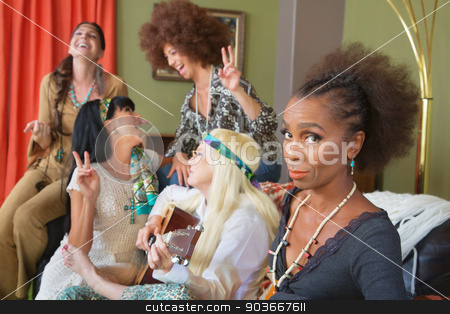 Serious Woman WIth Laughing Friends stock photo, Serious African woman with friends laughing and singing by Scott Griessel