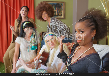 People Arguing About Music stock photo, Group of frustrated women trying to sing and play music by Scott Griessel