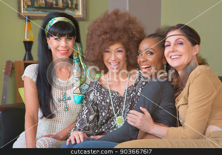 Group of Four Giggling Hippies stock photo, Diverse group of four beautiful women in hippie clothes by Scott Griessel