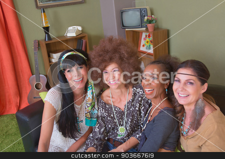 Group of Four Smiling Ladies stock photo, Cheerful smiling mature women sitting on leather sofa by Scott Griessel