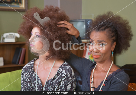 Unimpressed Lady with Friend stock photo, White woman with afro wig and unimpressed friend by Scott Griessel