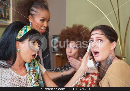 Embarrassed Ladies on Phone stock photo, Embarrassed group of female friends listening to telephone by Scott Griessel