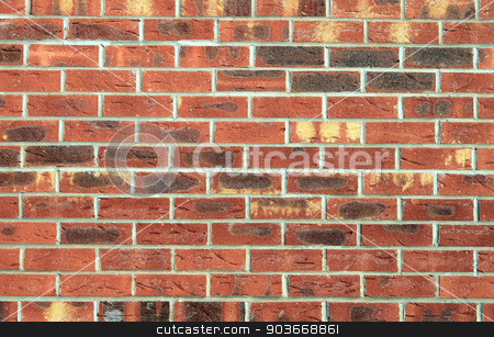 Brick wall background stock photo, Textured surface of a brick wall background. by Martin Crowdy
