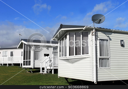 Caravan park in summer stock photo, Scenic view of a caravan or trailer park in summer with blue sky and cloudscape background. by Martin Crowdy