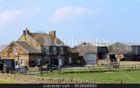 Farm in the countryside stock photo, Scenic view of a farm and barn in the countryside, Whitby, North Yorkshire, England. by Martin Crowdy