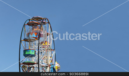 Ferris wheel background stock photo, Ferris wheel with blue sky background and copy space. by Martin Crowdy