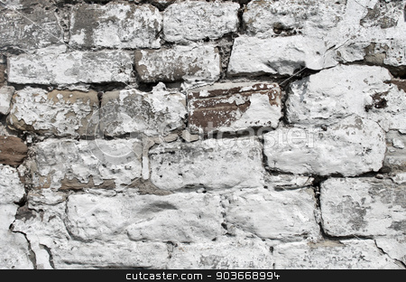 White dry stone wall stock photo, Abstract background of a painted white dry stone wall. by Martin Crowdy