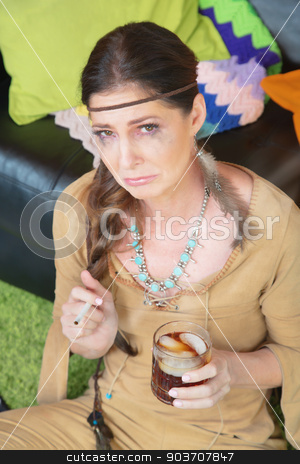Crying Woman with Whiskey stock photo, Single crying smoking woman holding liquor glass by Scott Griessel
