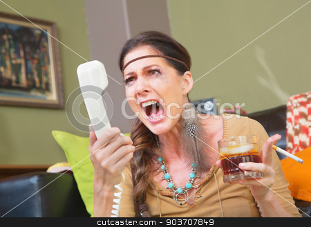 Angry Smoker Yelling at Phone stock photo, Angry smoker with drink yelling into telephone by Scott Griessel
