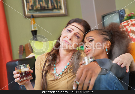 Drunk 1960s Women stock photo, Pair of sad adult women drinking and smoking by Scott Griessel