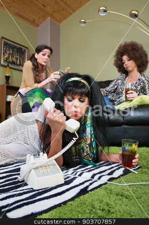 Sulky Lady Holding Phone stock photo, Sulky mature white female holding phone and drink by Scott Griessel