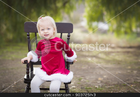 Adorable Little Girl Sitting in Her Chair Outside stock photo, Adorable Little Girl Sitting in Her Rocking Chair Outside. by Andy Dean