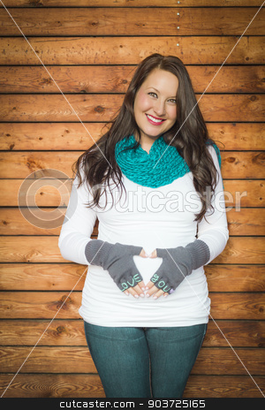 Beautiful Young Pregnant Woman with Love You Mittens  stock photo, Beautiful Young Pregnant Woman Holds Her Stomach with Love You Mittens. by Andy Dean